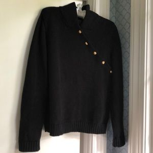 RL black sweater with gold buttons, high collar.